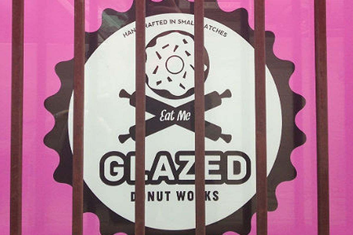 A sign in the window at Glazed Donut Works.