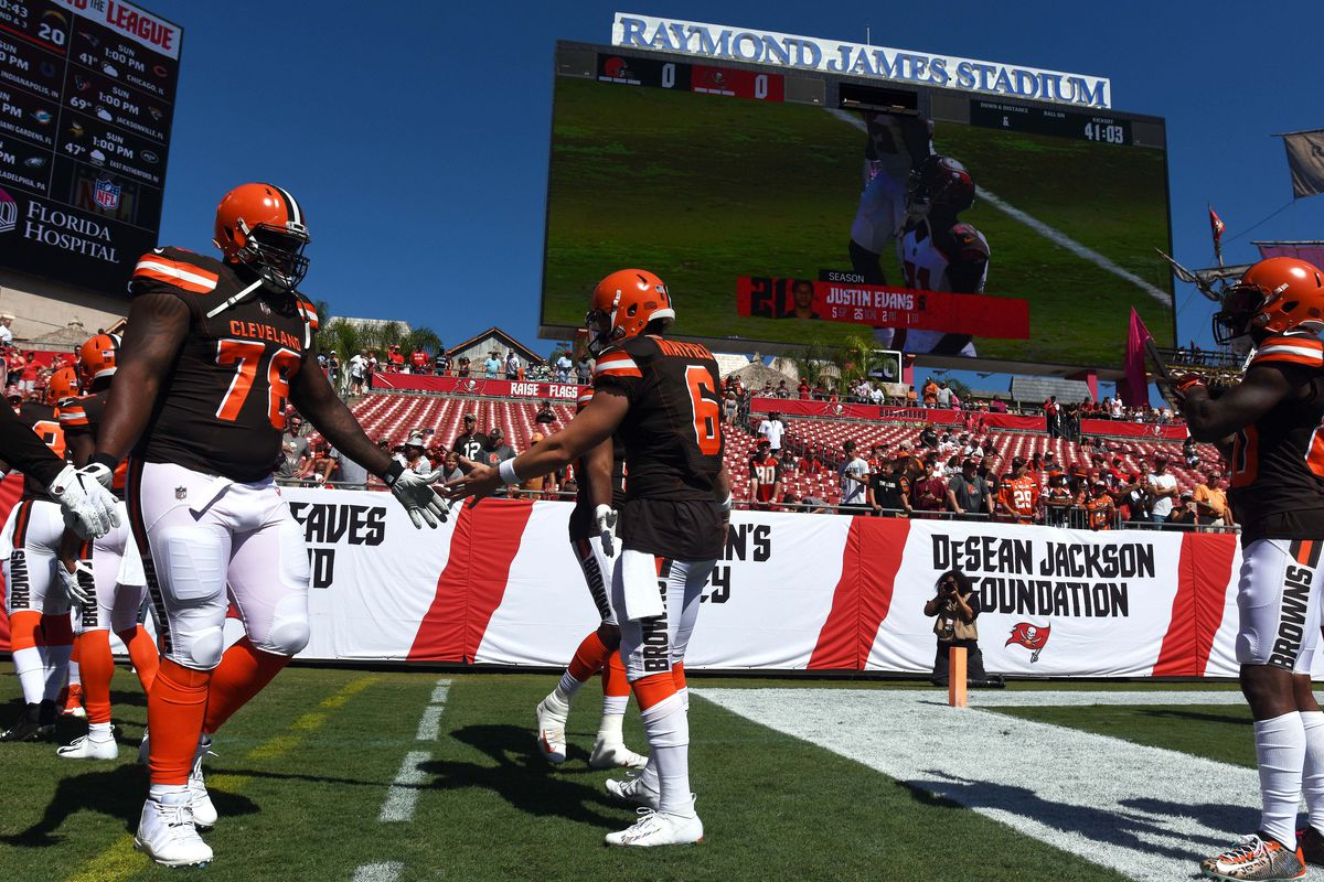 Cleveland Browns quarterback Baker Mayfield greets offensive lineman Greg Robinson before the start of the game against the Tampa Bay Buccaneers at Raymond James Stadium.