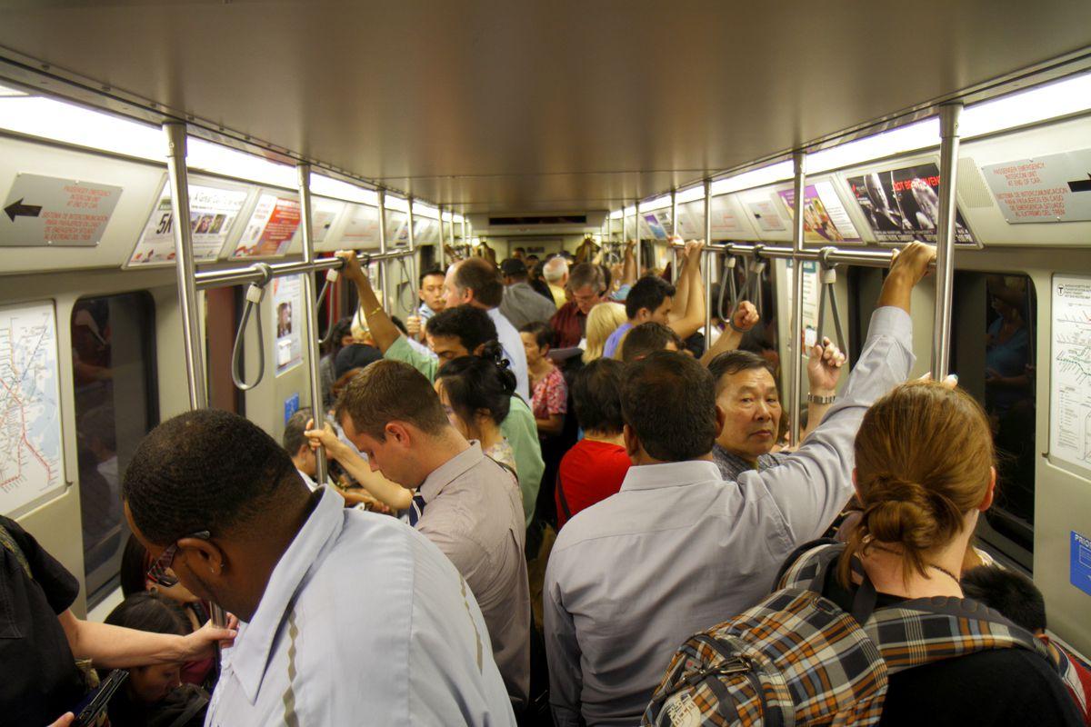 A crowd on a T train
