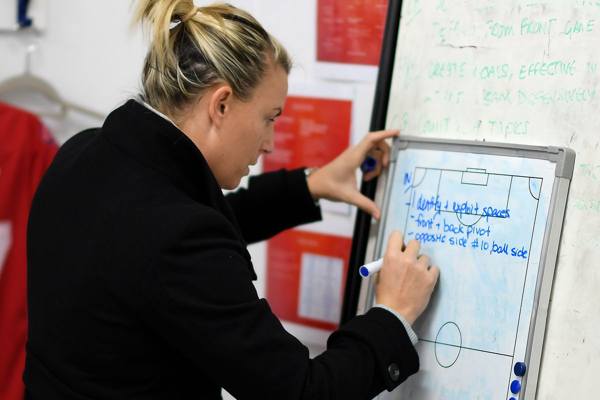 Coach Tanya Oxtoby writes out tactics - Women's FA Cup