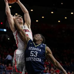 Arizona's Alex Barcello, rear, shoots the ball past a hand in the face from Georgia Southern's Isaiah Crawley (53) during the Arizona-Georgia Southern game in McKale Center on November 29 in Tucson, Ariz. Barcello had 16 points in the game.