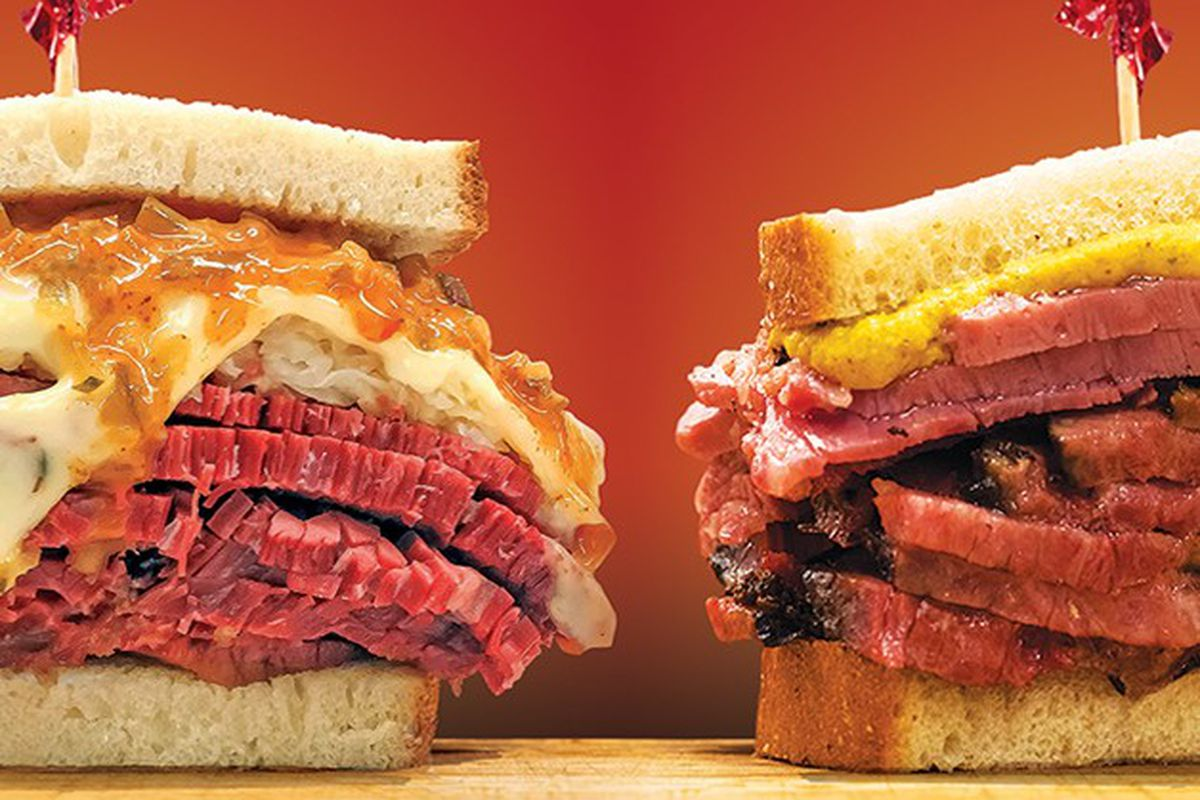 Two pastrami sandwiches with mustard.