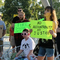 Laura Strickland listens to speakers during a rally in Salt Lake City on Saturday, Sept. 2, 2017. Nearly 100 people gathered in Salt Lake City at a rally protesting police conduct against a University Hospital nurse who refused to allow a blood draw from an unconscious patient.