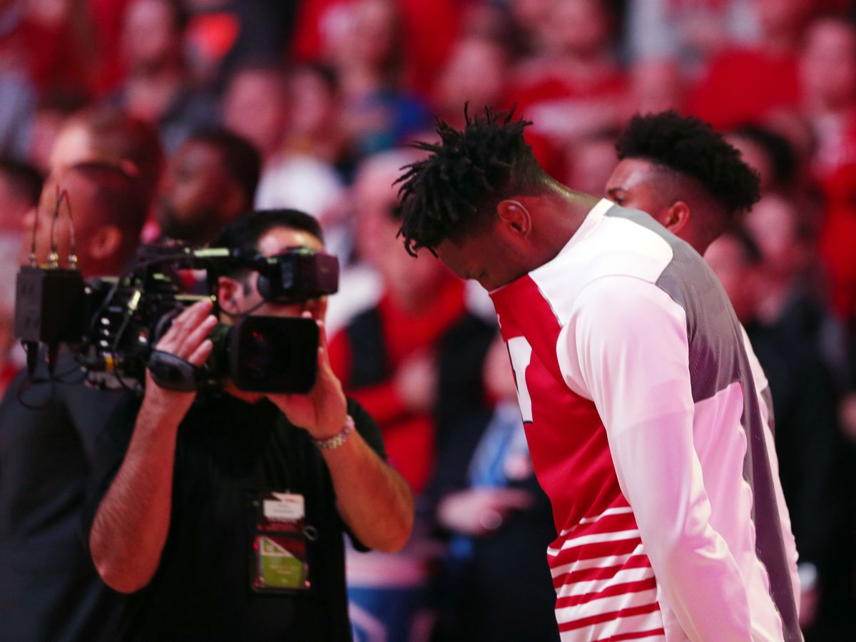A BTN videographer records Wisconsin Badgers forward Nigel Hayes as he stands behind his teammates during the playing of the National Anthem before the game with the Michigan Wolverines at the Kohl Center.