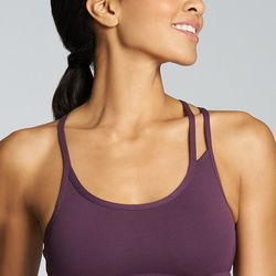 """Our pick: How very Helmut Lang, no? With colors in purple, black and hot pink, you can't go wrong in this number. Try it with palazzo pants or a street-sweeping skirt in a matching hue. Omemee sports bra, $24.95 at <a href=""""http://www.fabletics.com/index."""