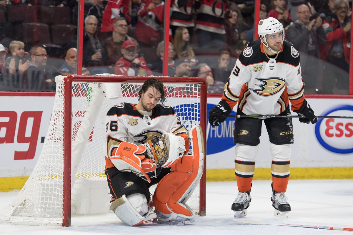Feb 7, 2019; Ottawa, Ontario, CAN; Anaheim Ducks goalie John Gibson (36) is shaken up after colliding with defenseman Jaycob Megna (43) on a goal by Ottawa Senators center Matt Duchene (not pictured) in the second period at the Canadian Tire Centre.