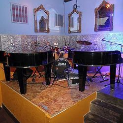 A dueling piano stage that sits next to the bar.