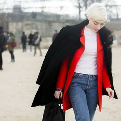 A layered coat look outside of the shows at Paris Fashion Week.