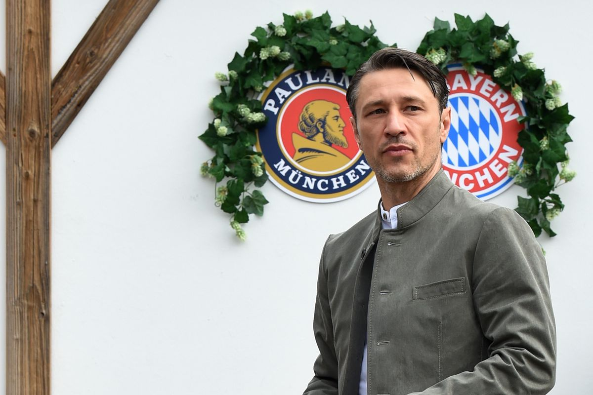 Bayern Munich's Croatian headcoach Niko Kovac wears a traditional Bavarian Lederhosen (leather trousers) dress as he arrives for his football team's annual visit at the Oktoberfest beer festival in Munich, southern Germany, on October 7, 2018.
