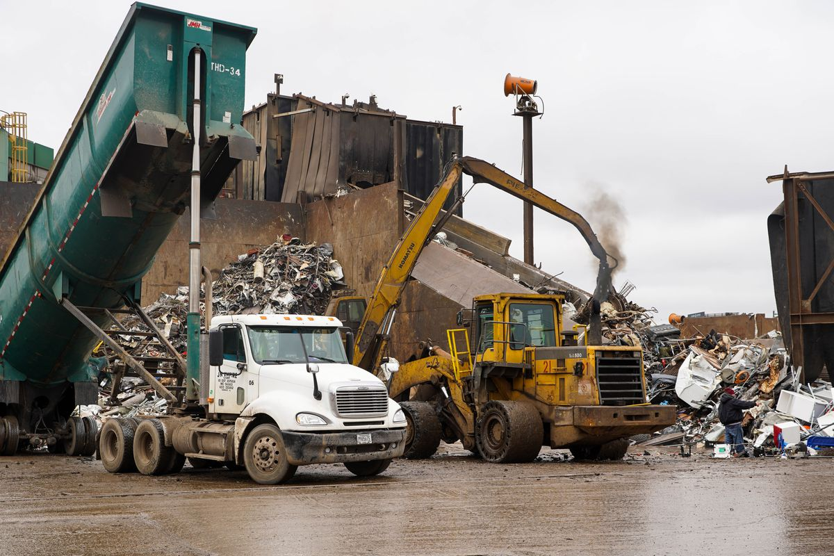 Trucks dump metal scraps into a pile at General Iron in Lincoln Park. | Annie Costabile/Sun-Times
