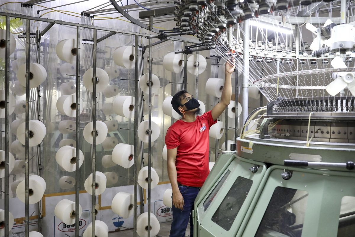 An employee works in a knitting section of a Textile Mills Limited in Gazipur, Bangladesh, on February 16, 2021.