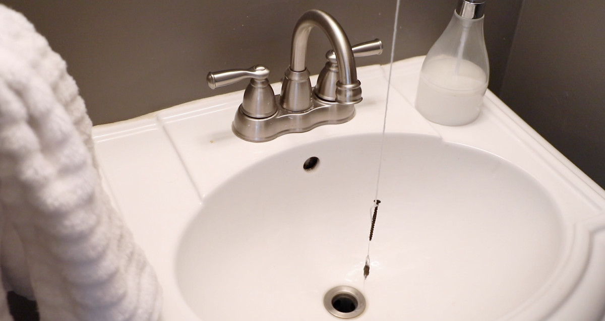 Snaking a sink with string and a drywall screw.