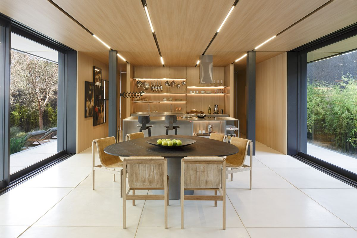 Kitchen with table and light wood ceiling