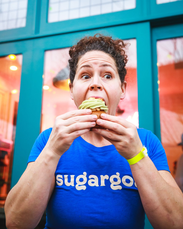 Chef Stephanie Izard snarfs down a cupcake with green frosting.