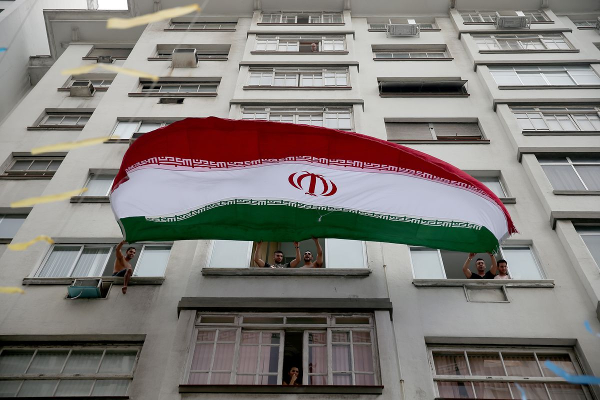 The Iranian flag outside an apartment building.