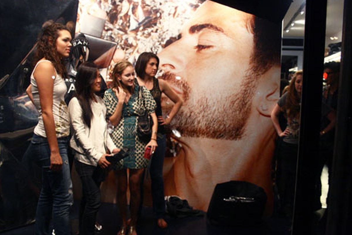 Girls pose in front of the floating head of Marc Jacobs on FNO. Image by Randy Ceballos for Racked NY