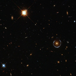 """<a class=""""colorful"""" href=""""http://spacetelescope.org/images/potw1151a/"""">Looking at an Einstein Ring (2011)</a>"""
