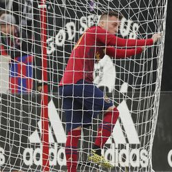 Real Salt Lake forward Corey Baird (10) stands in the net after a near miss shot in Sandy on Saturday, March 7, 2020. RSL tied with New York 1-1.