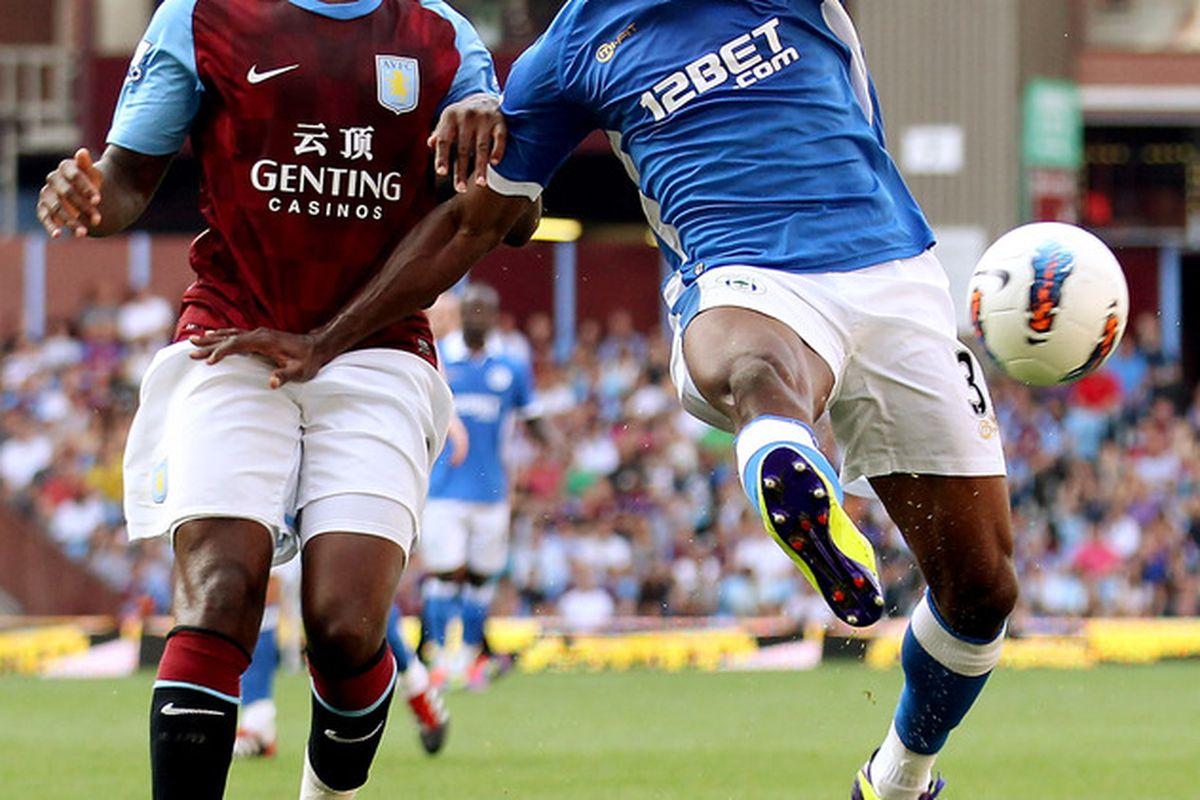 Figeroua battles with Darren Bent, as Latics lose 2-0 to Aston Villa