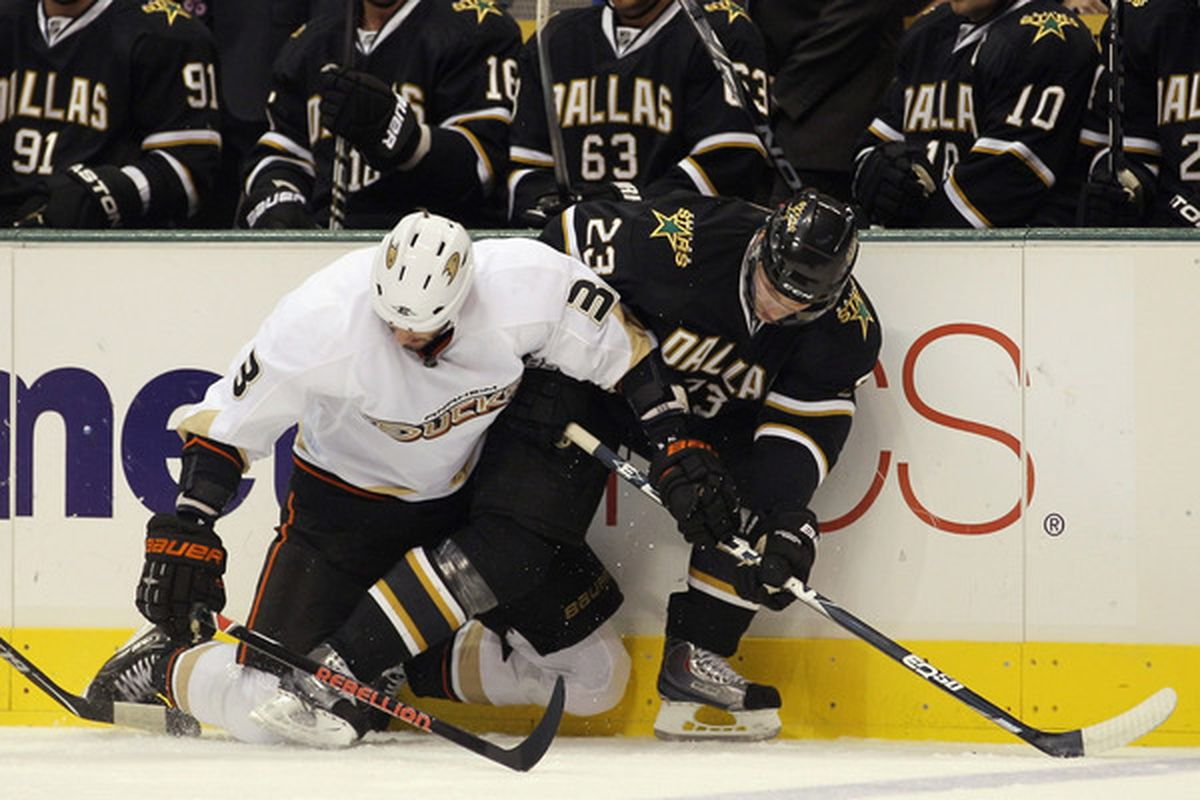 DALLAS - OCTOBER 26: Andreas Lilja #3 of the Anaheim Ducks hangs on to Tom Wandell #23 of the Dallas Stars as they pursue the puck at the American Airlines Center on October 26 2010 in Dallas Texas.  (Photo by Bruce Bennett/Getty Images)
