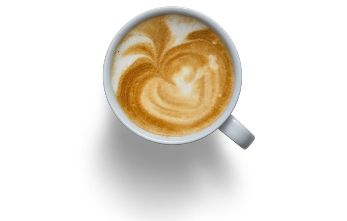A latte in a white mug shown from above on a white background.