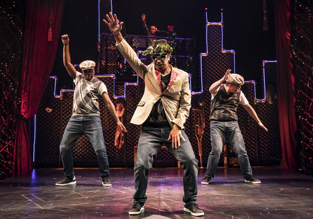 """The Ghost of Christmas Present (JQ) is surrounded by his crew (Pos and Jax) in Chicago Shakespeare Theater's production of """"Q Brothers Christmas Carol."""""""