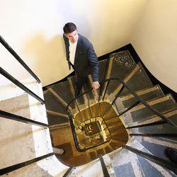 Utah Valley University President Matthew Holland walks down a stairway at Pembroke College, Oxford University, England, on June 14, 2017.