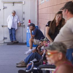 Homeless people wait outside the St. Vincent De Paul Dining Hall in Salt Lake City for dinner at 5 p.m. on Thursday, June 29, 2017.