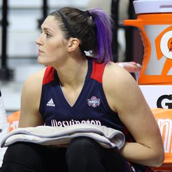 Washington Mystics' Stefanie Dolson (31) sits on the bench with a hot pack on her legs.