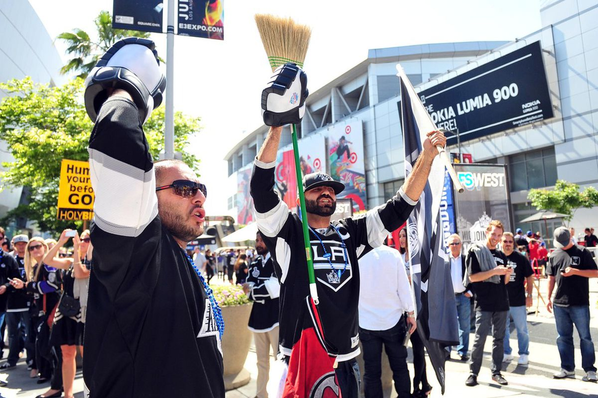 June 6, 2012; Los Angeles, CA, USA; Los Angeles Kings fans hold up brooms as they arrive before game four of the 2012 Stanley Cup Finals against the New Jersey Devils at the Staples Center.  Mandatory Credit: Gary A. Vasquez-US PRESSWIRE