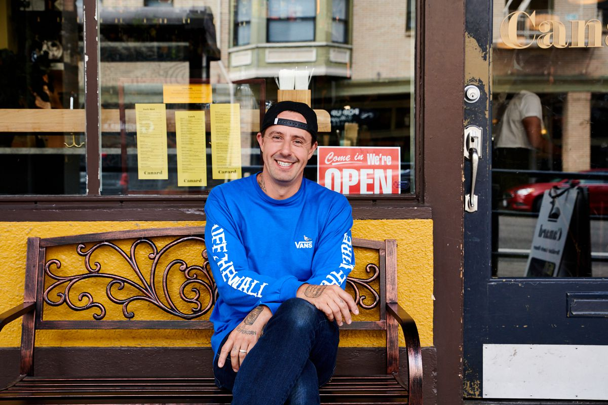 A picture of a smiling Gabriel Rucker outside his restaurants, Canard and Le Pigeon