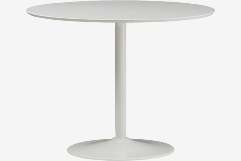 White round table with round base.