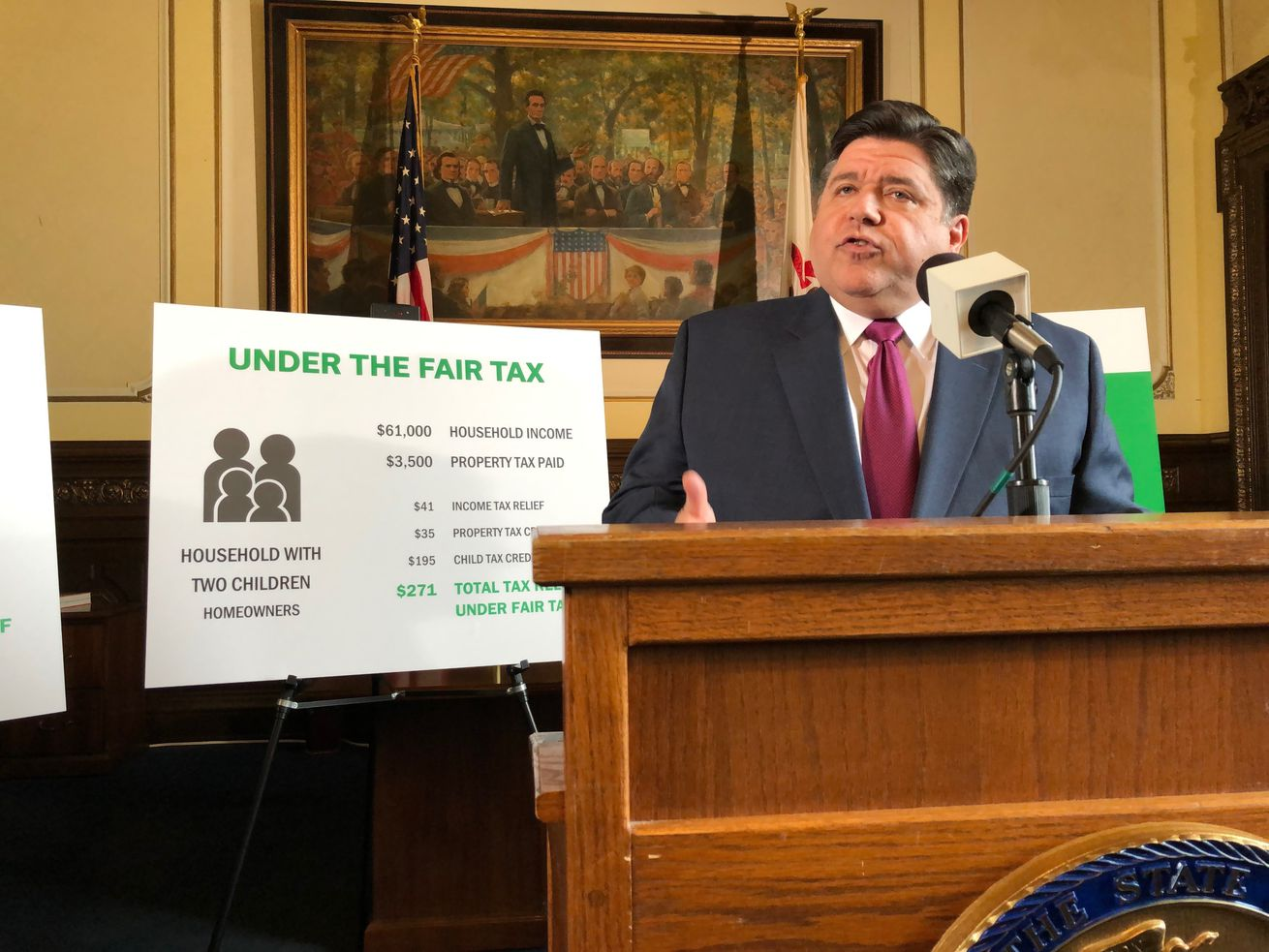 Gov. J.B. Pritzker outlines his plan to replace Illinois' flat-rate income tax with a graduated rate structure, at a news conference on March 7, 2019 in Springfield.