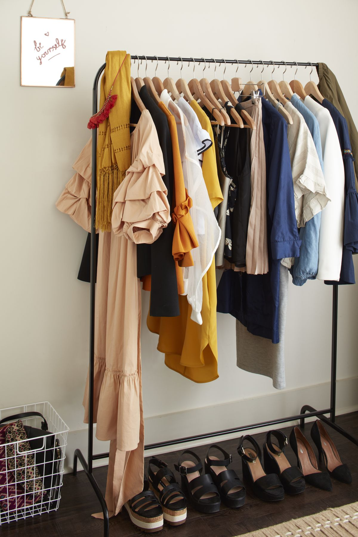 She stores the clothes she wears often on an open rack in the bedroom.