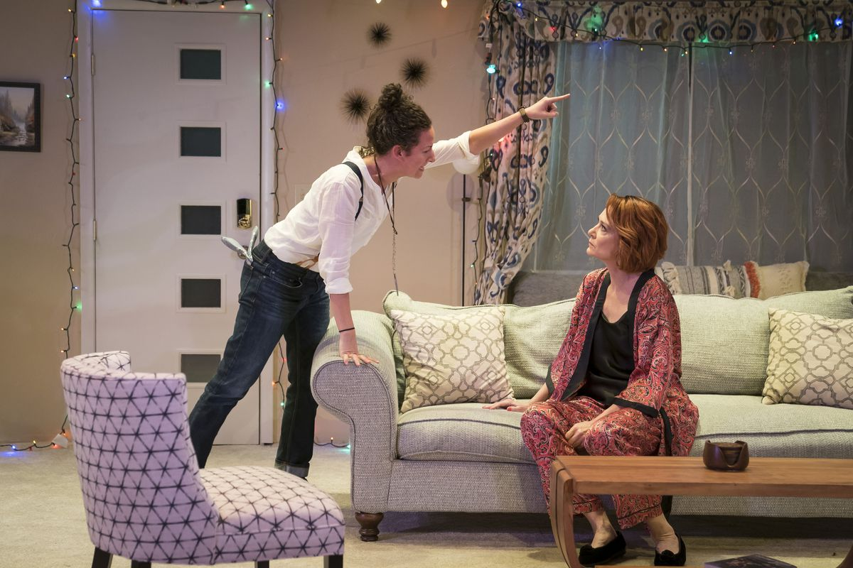 """Kristina Valada-Viars (left) and Shannon Cochran in a scene from """"Act(s) of God"""" at Lookingglass Theatre.   Liz Lauren"""