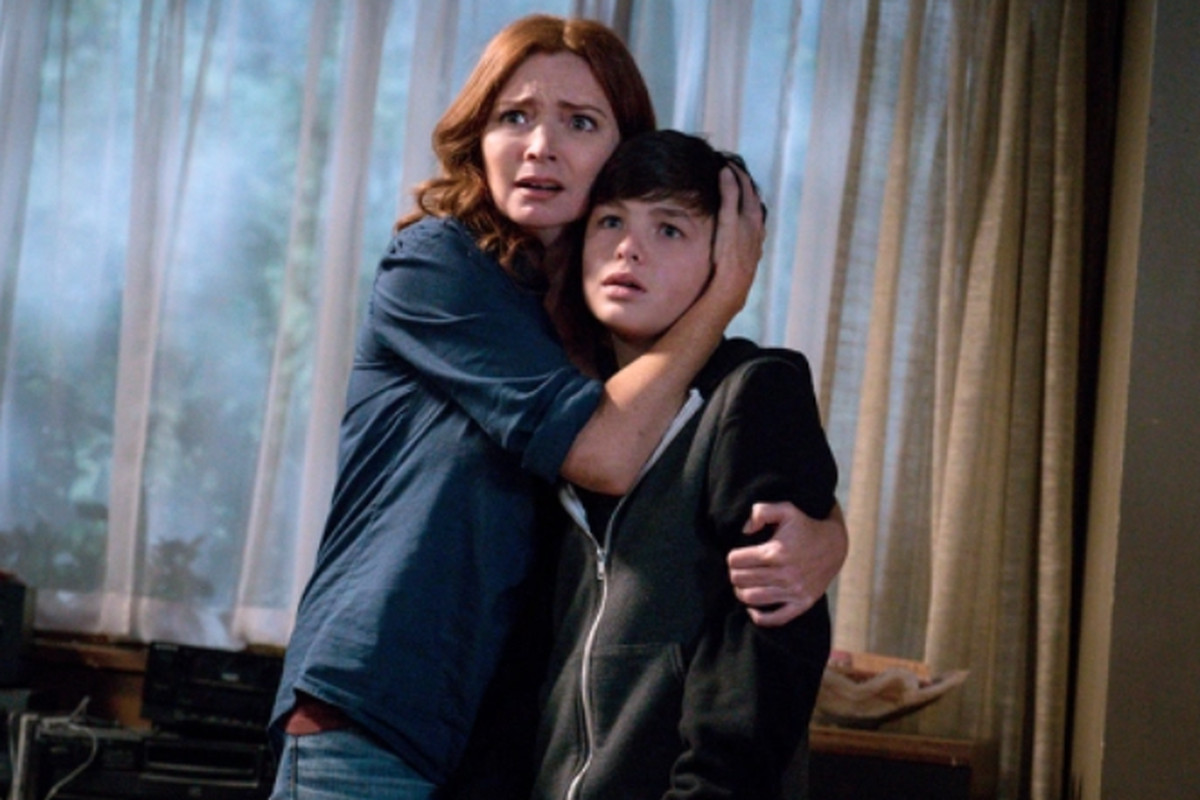 """Brigid Brannagh and Logan Williams in an episode of the CW series """"Supernatural."""""""