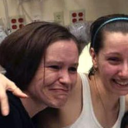 Amanda Berry, right, hugs her sister Beth Serrano after being reunited in a Cleveland hospital Monday May 6, 2013. Berry and two other women were found in a house near downtown Cleveland Monday after being missing for about a decade.
