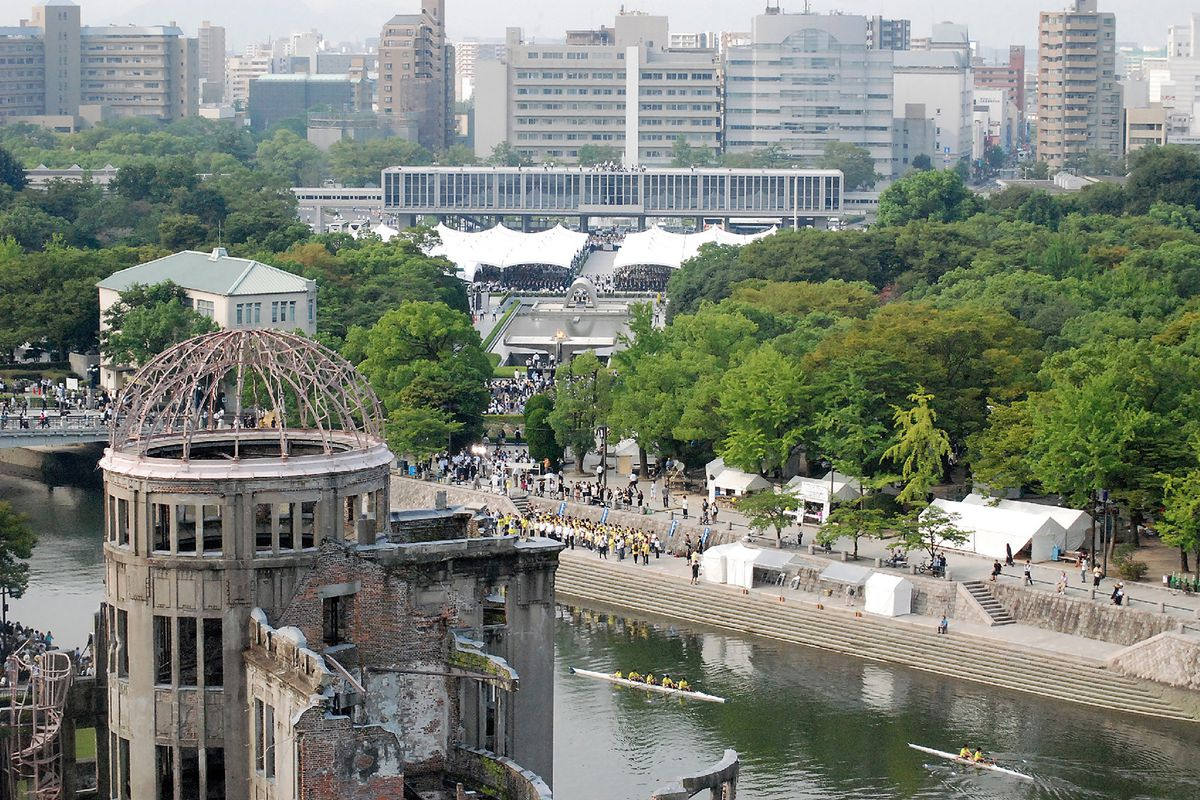 Hiroshima atomic bomb dome with Hiroshima Peace Memorial Park in background