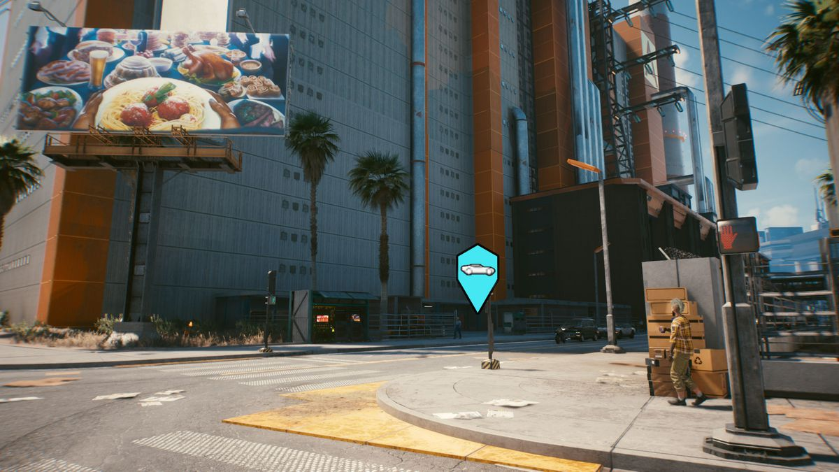 A warehouse with a large billboard in front of it in Cyberpunk 2077