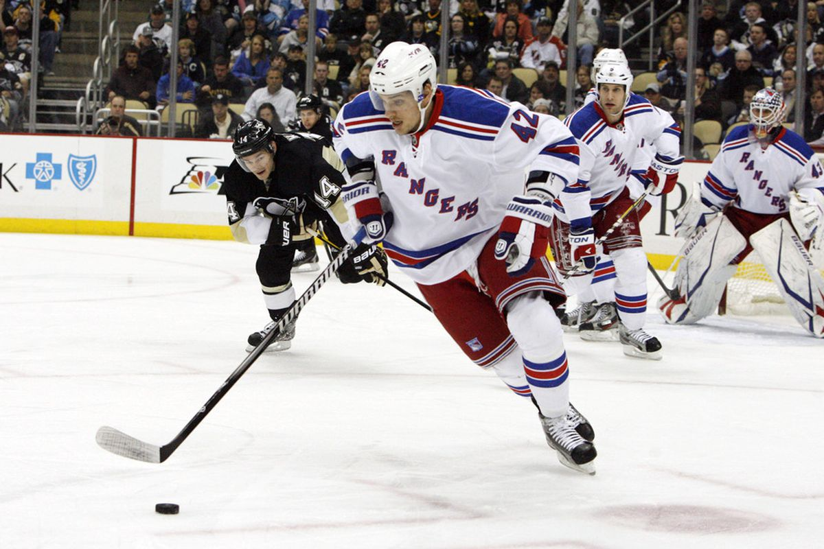 April 5, 2012; Pittsburgh, PA, USA; New York Rangers center Artem Anisimov (42) moves the puck up ice against the Pittsburgh Penguins during the first period at the CONSOL Energy Center. Mandatory Credit: Charles LeClaire-US PRESSWIRE