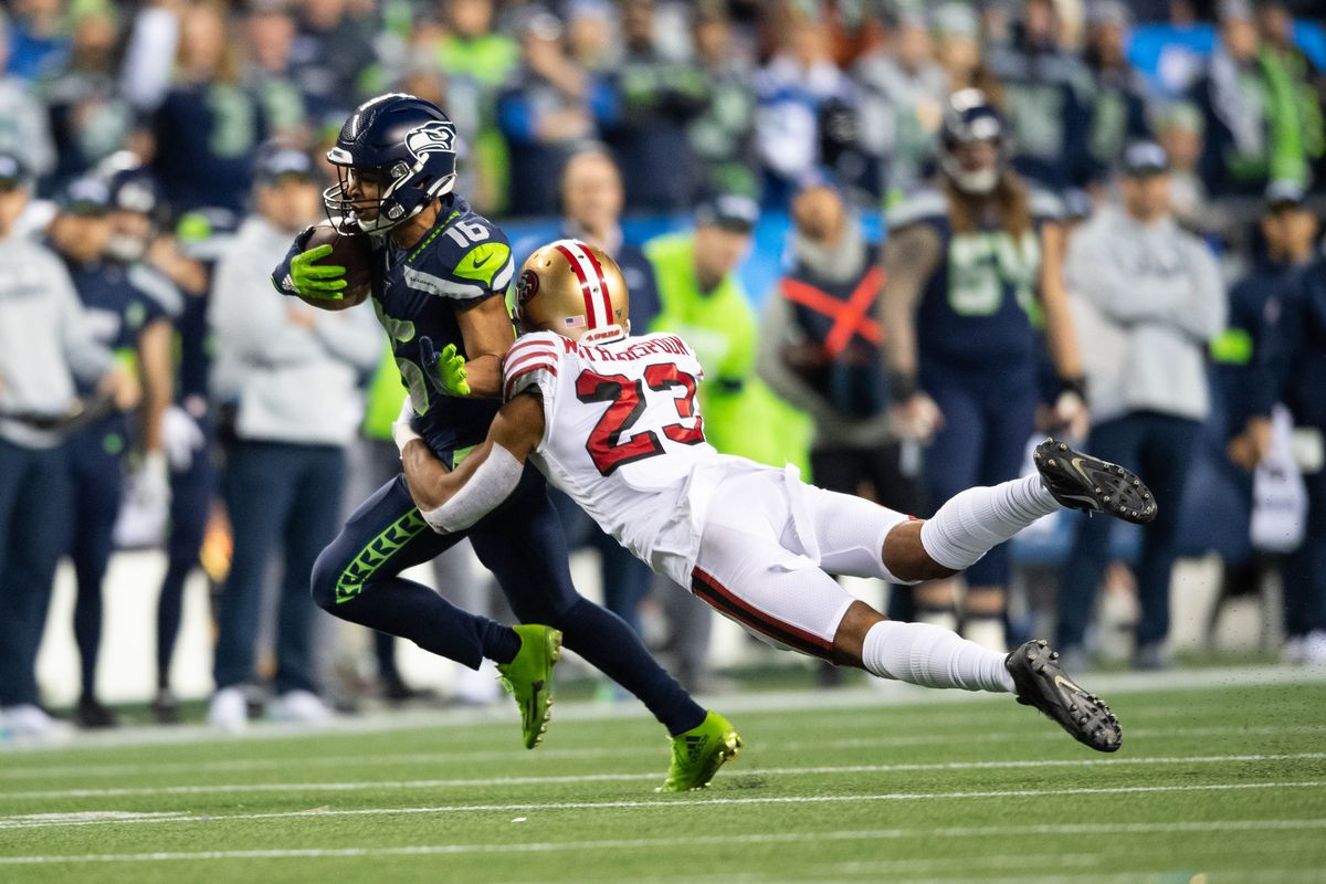 San Francisco 49ers cornerback Ahkello Witherspoon dives to tackle Seattle Seahawks wide receiver Tyler Lockett during the first half at CenturyLink Field.