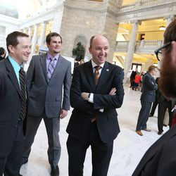 Lt. Gov. Spencer Cox talks with students Lucas Smith, Zak Dymock and Carson Sparks as University of Utah and Utah State University students show their research for Utah lawmakers in rotunda of the state Capitol in Salt Lake City, Tuesday, Jan. 26, 2016.