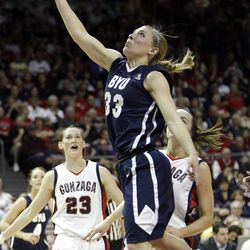 Brigham Young Cougars guard Haley Steed (33) drives by Gonzaga Bulldogs guard/forward Katelan Redmon (23)  in the West Coast Conference finals in Las Vegas  Monday, March 5, 2012.  BYU won the title and will advance to the NCAA tournament.