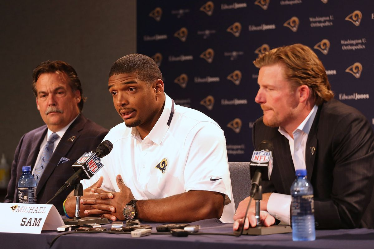 Michael Sam with Rams coach Jeff Fisher, left, and GM Les Snead after being drafted in 2014.