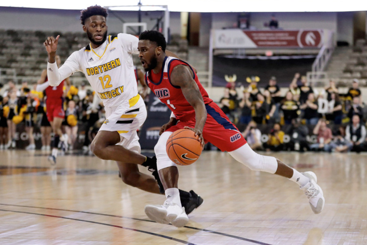 UIC guard Marcus Ottey drives against Northern Kentucky guard Trevon Faulkner at the Horizon League tournament championship on Tuesday in Indianapolis.