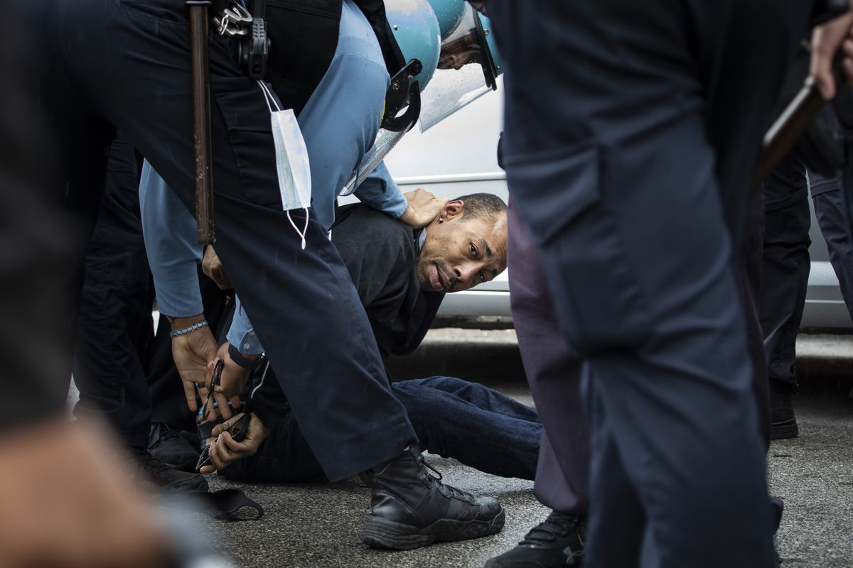 A man is taken into Chicago police custody