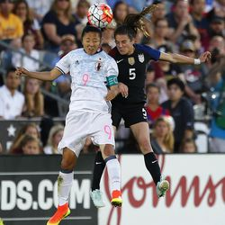 Japan forward Yuki Ogimi (9) and U.S. defender Kelley O'Hara (5) go up for a head ball during the first half of an international friendly soccer match Thursday, June 2, 2016, in Commerce City, Colo. The match ended in a 3-3 draw. (AP Photo/Jack Dempsey)