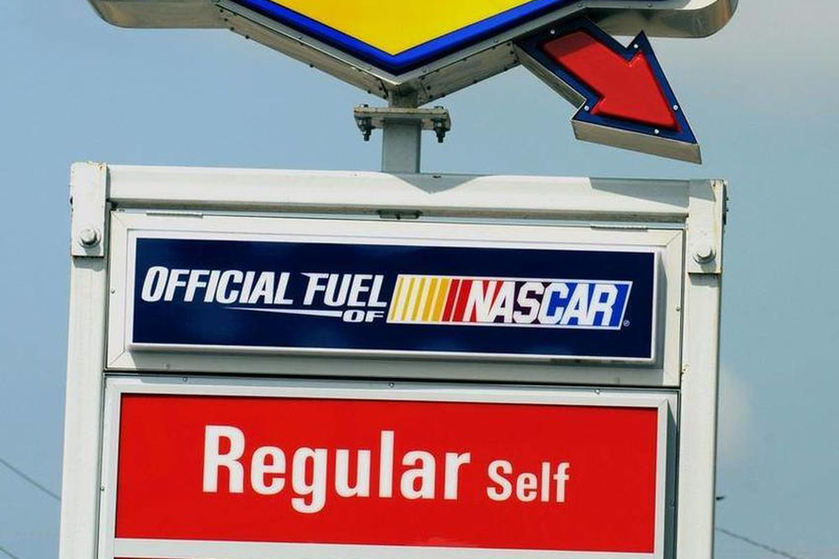 Gas prices appear on a Sunoco station sign located in Wilmington, N.C. on Monday, April 30, 2012. Energy Transfer Partners is buying Sunoco in a $5.3 billion deal that creates one of the more diverse pipeline companies in the country.