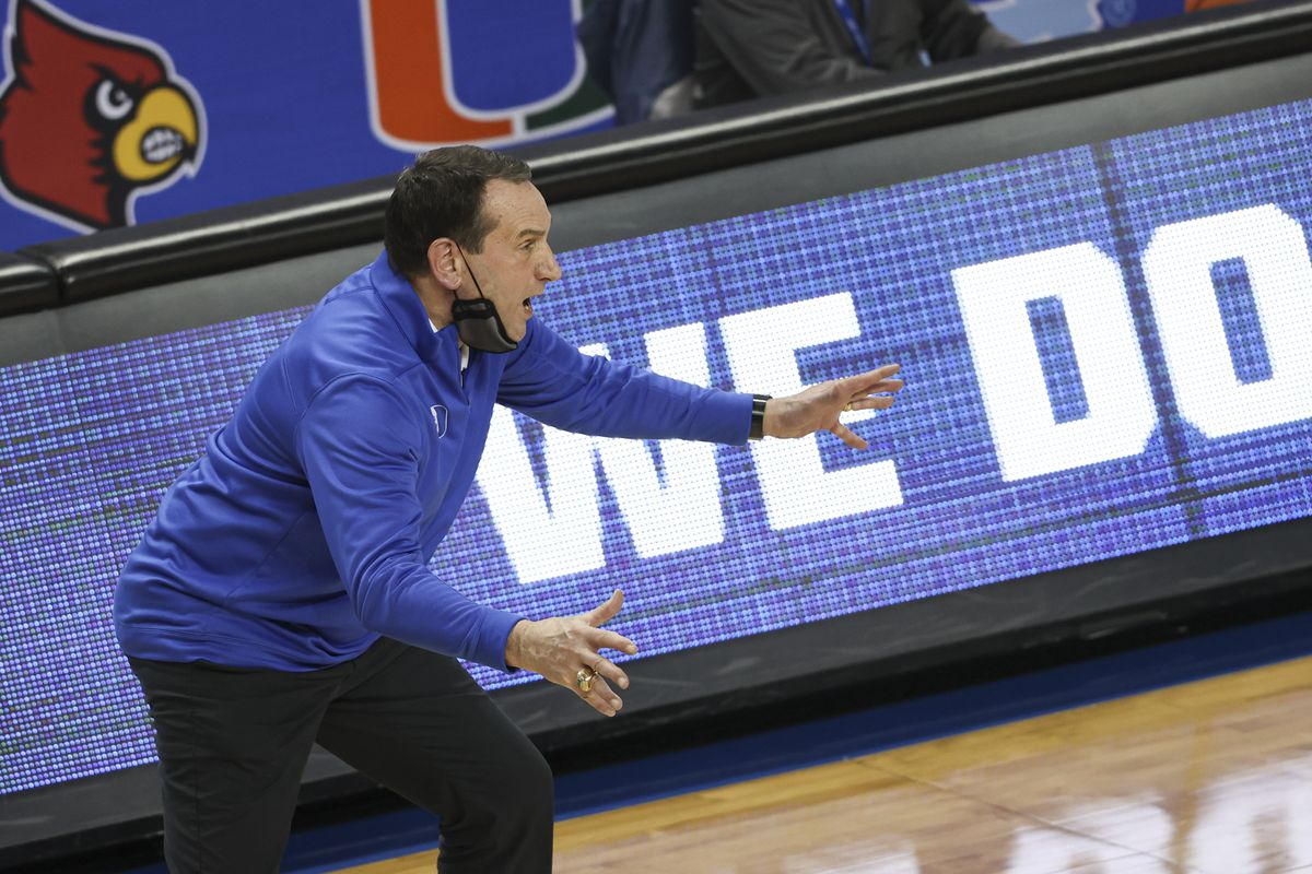 Duke Blue Devils head coach Mike Krzyzewski watches his team play the Louisville Cardinals during the second half in the second round of the 2021 ACC tournament at Greensboro Coliseum. The Duke Blue Devils won 70-56.