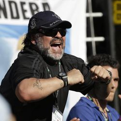 Former soccer ace Diego Maradona celebrates a point by Argentina's Juan Monaco against Czech Republic's Tomas Berdych during the Davis Cup semifinal match in Buenos Aires, Argentina,  Friday, Sept. 14, 2012.